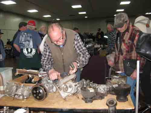 Captain of Industry examines parts at the Swap Meet