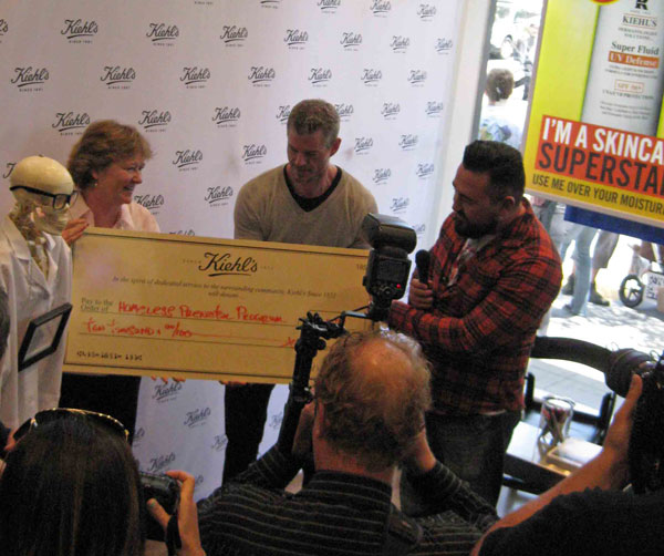 Kiehl's US president, Chris Salgrado presents the check to the homeless prenatal program.  photo by Paul d'Orleans