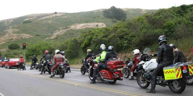 Motorcyclists waiting for a green light to go through the tunnel. photo by Paul d'Orleans
