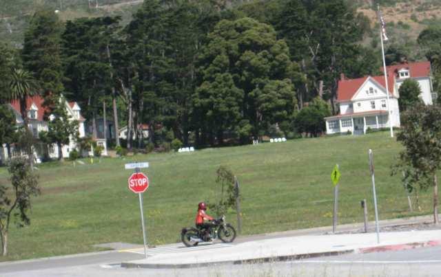 Kim arrives on her Velocette at Cavallo Point