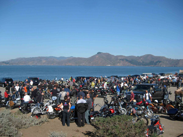 View of a parking lot full of motorcycles at Baker Beach