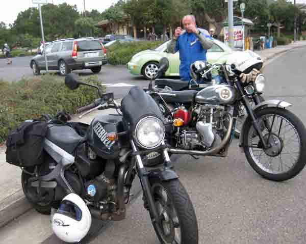 After removing my helmet and saddlebags from my Buell, I jumped on the back of the nearby Velocette Endurance.  Fred Mork with his Velocette Venom is in the background.