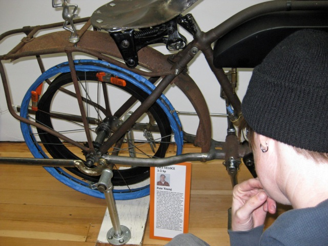 Someone contemplates the rear wheel of Pete Young's 1913 Veloce