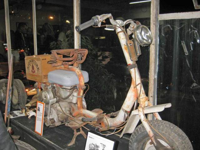 A scooter in the window