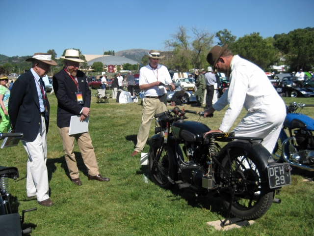 Jeff starts the Royal Enfield for the judges (Paul Adams and Red Fred)