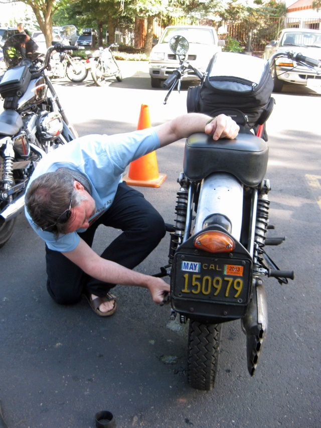 Dai checks the nuts and bolts on the Endurance.