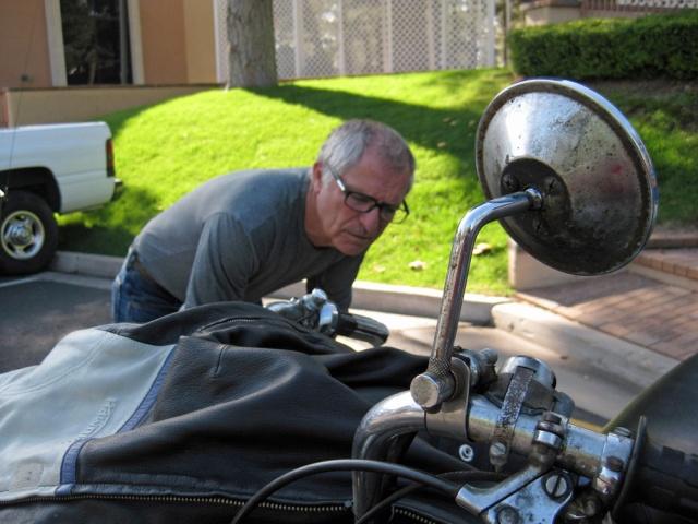 Lynn examines his bike.