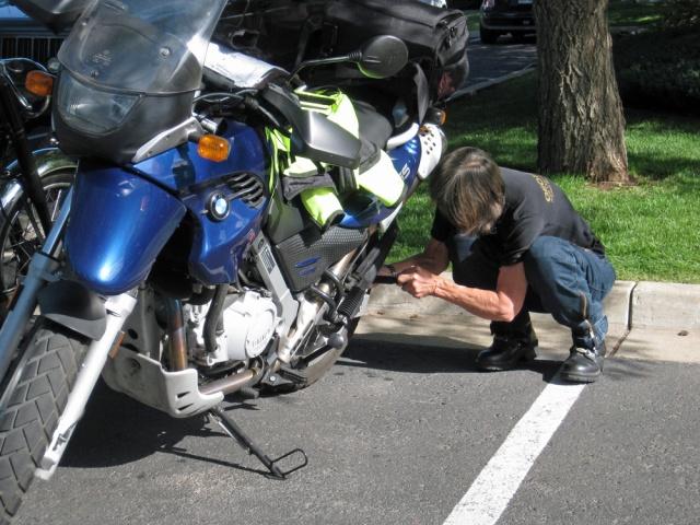 Mavis prepares her bike.