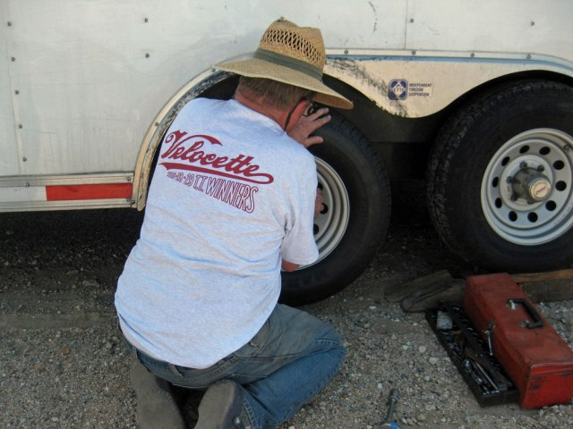 Fred changes the first tire
