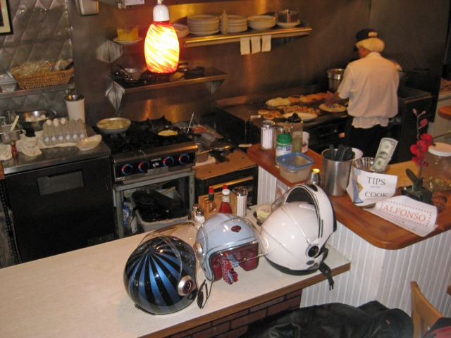 Stylish helmets can't compete with the chef's thick white hair