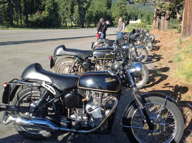 Velocettes and other bikes parked outside of the Mineral Lodge