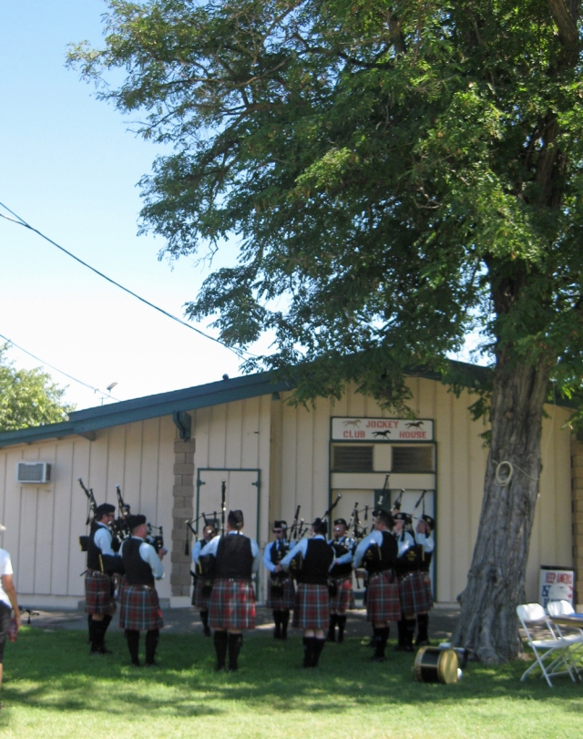 One of the many bagpipe bands warms up