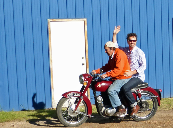 Ron gives Paul a ride back to the hotel.  There's no helmet law in Idaho.