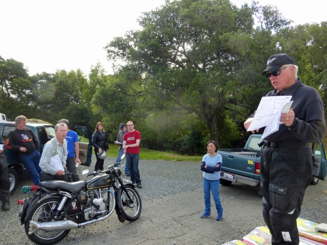 John Ray hosts riders meeting to a somewhat attentive audience